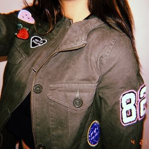 Patched olive green jacket.
